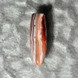 Laguna Agate Hand Cut Free Form Designer Cabochon With Fortification Patterns in Reds Grays and White Colors 51.3 x 16.6 x 6.3mm #4229LAG