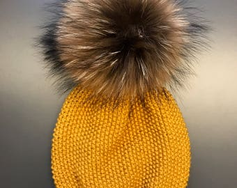 Merino wool  hat with a real fur pompon
