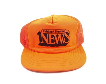 6373ad60df607 vintage Fishing + Hunting News mesh snapback trucker hat
