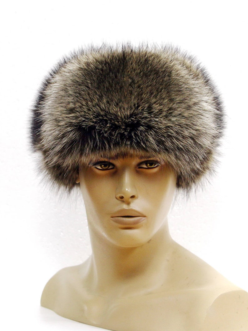 31ad71c5bad Winter fur hat from a raccoon and a leather Ushanka hat