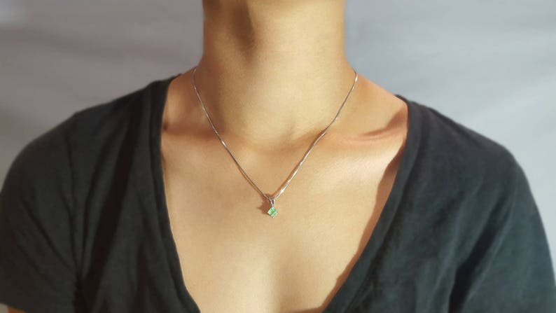 Solitaire Square Cut Emerald in Diamond Shaped Pendant