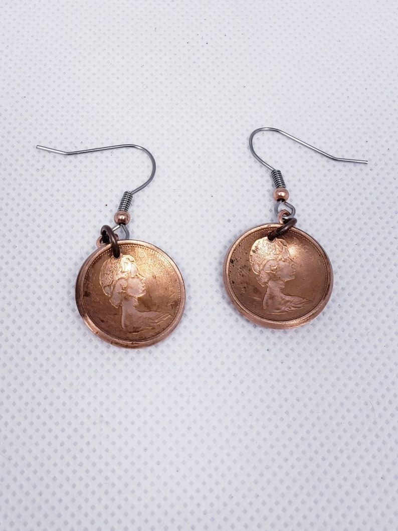 Coin earrings hand made with 1967 Canadian Centennial pennies.