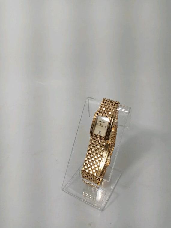 Vintage Wittnauer gold tone 4 diamond face Swiss m