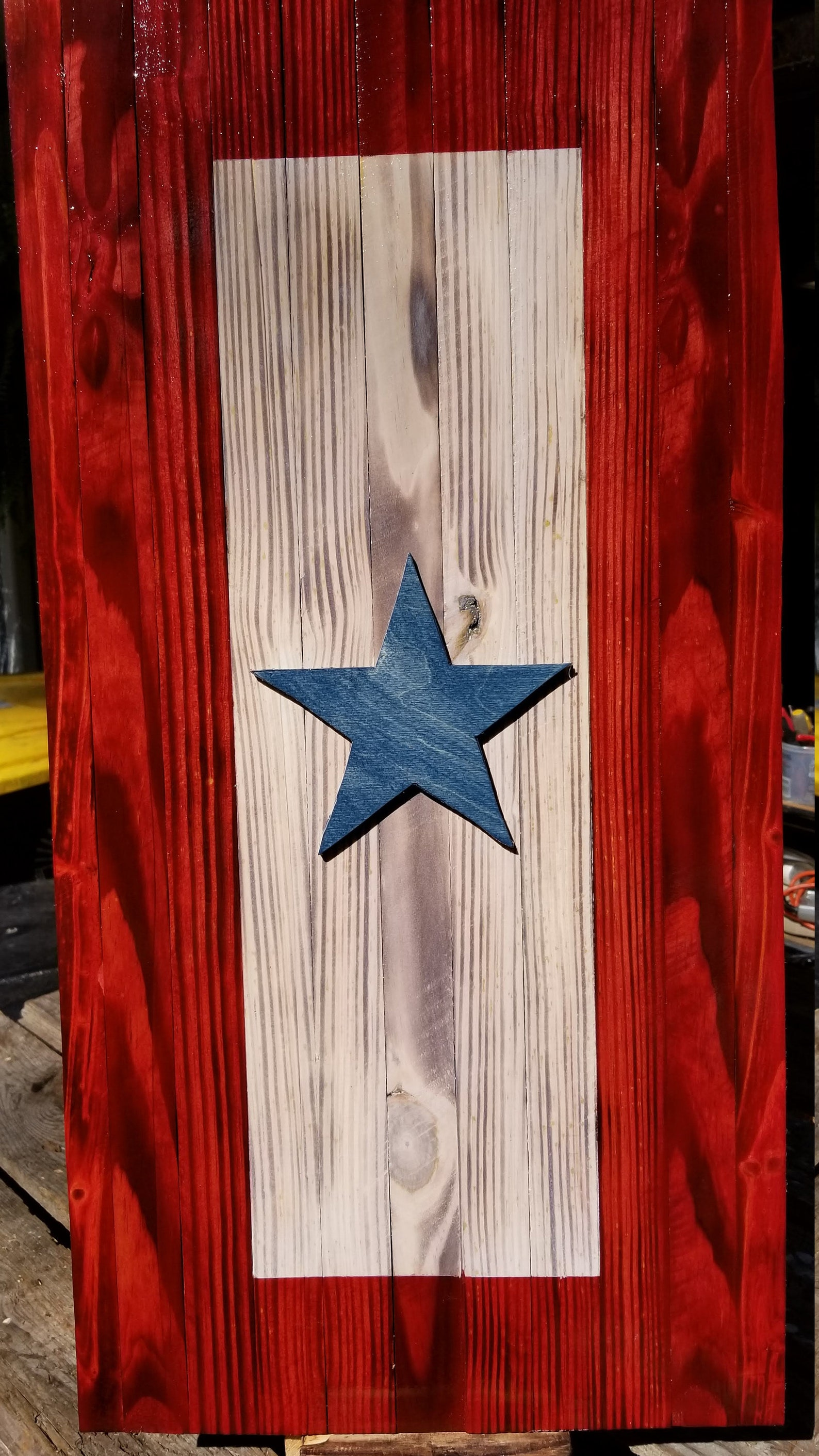 Deployment flag: rustic rectangle with red on the outside, neutral beige in the middle and blue star in the center.
