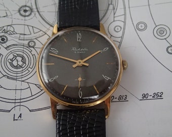 8b94e81fc36a Vintage classic goldplate black dial wristwatch RAKETA Paketa-Rocket