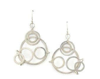 Circle orbit earrings