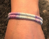 Hand dyed thread wrapped woven bracelet