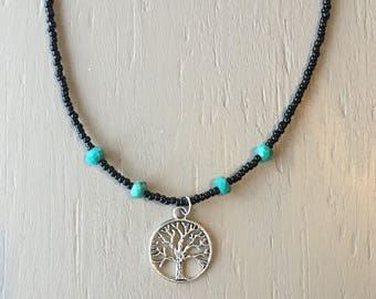 Beaded necklace with tree charm