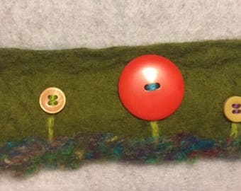 Handmade wet felted bracelet with button flowers