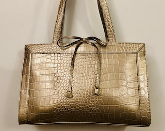 eb48a3b8c2 Liz Claiborne - A light golden mock croc leatherette handbag with a couple  of 17