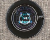 You've been poisoned. | Vulgar vintage style black 8oz cappuccino cup with matching 'Bye.' saucer