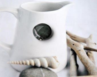 1 dark grey ceramic bead