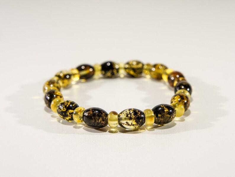 Amber bracelet dark black elliptical and lemon yellow image 0