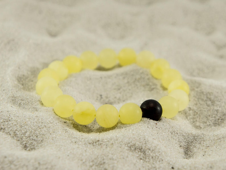 Amber bracelet sunny unpolished round and dark natural amber image 0