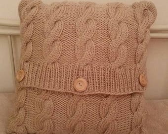 Handknitted cable cushion