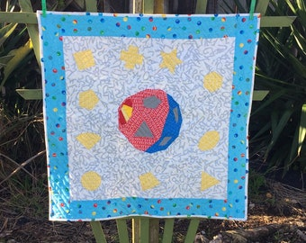 Shape O Ball Baby Quilt Pattern, Easy Paper Pieced New Baby Gift Quilt, includes geometric shapes.