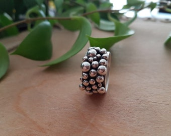 Sterling silver wide band statement ring