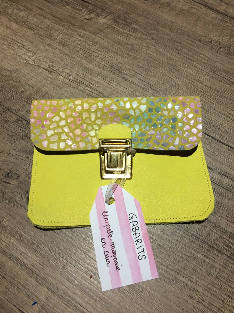 Yellow leather wallet and scales