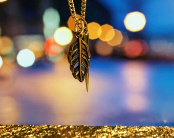 Feather and stake necklace
