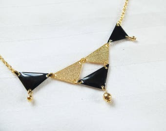 Necklace graphic black and gold sequins