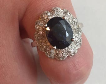 Silver ring set with a sapphire and white Topaz / T 52