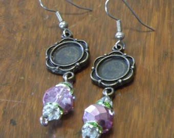Flower earrings with mauve crystals