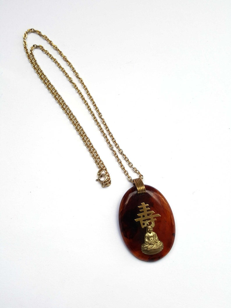 1950s bakelite pendant necklace with Asian theme root beer bakelite buddha necklace vintage