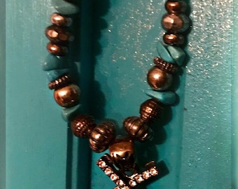 Two Criss Crossed Diamond Antique Silver Patina Revolvers on Beaded Chain of Turquoise Stones, Brass Beads and Brown Beads