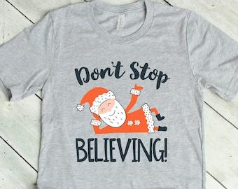 Don't Stop Believing Santa Tee
