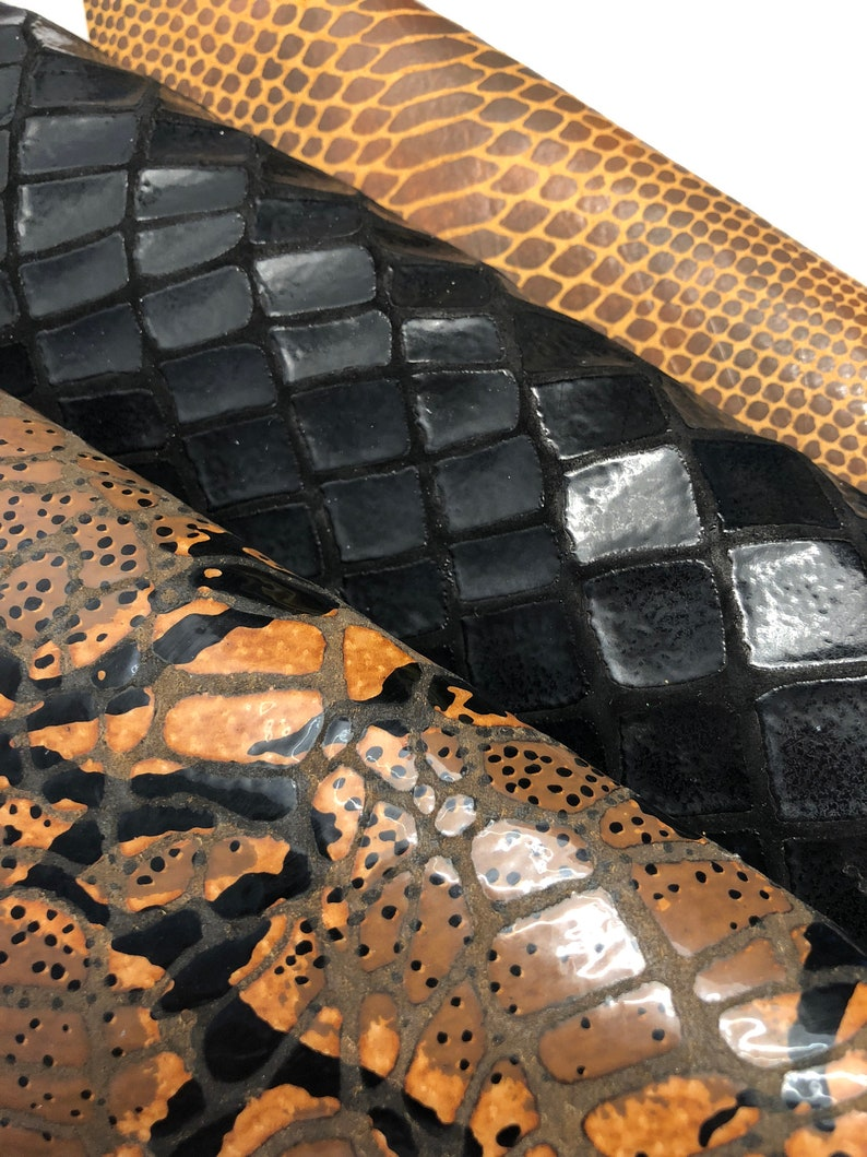 Let\u2019s Get Wild leather Set Black Large Croc and Camel Watersnake print in pearlized brown color. AMAZON COBRA SNAKE printed leather