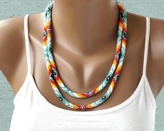 20 Native American inspired pendant on herringbone beaded cord