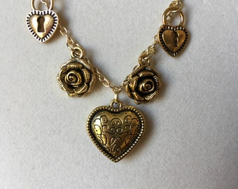 Antiqued gold tone heart necklaces