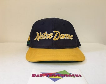 competitive price ba553 6b5dd Vintage 1990s Notre Dame Fighting Irish Script Blue Gold Sports Specialties  Twill Snapback Hat