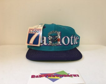 8dd8cd131ac New Dead Stock Vintage 1990s NBA Charlotte Hornets Teal Purple Logo 7 Snapback  Hat With All Original Tags!
