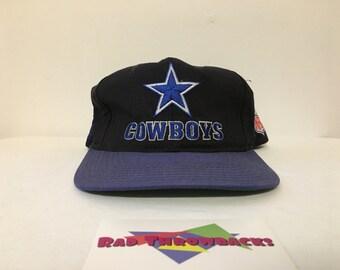 Vintage 1990s Dallas Cowboys Starter Black Blue Snapback Hat 162672e2b17