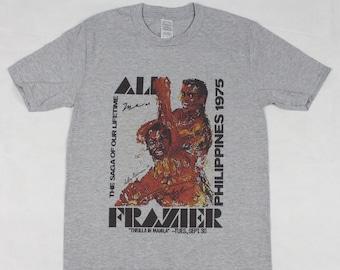 43cb97aa06f6 Muhammad Ali Vs Joe Frazier Thrilla in Manilla Grey T-shirt sizes available  S-3XL