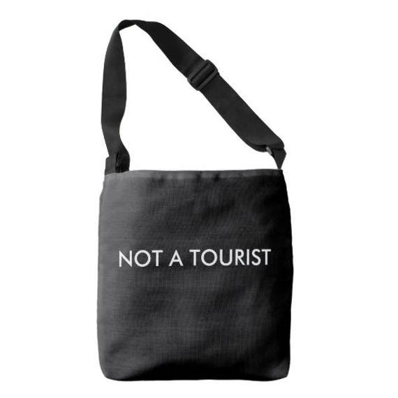 36c9bfd39529 NOT A TOURIST Cross-body Bag