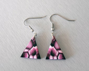 Earrings are made of purple and pink pattern kaleidoscope