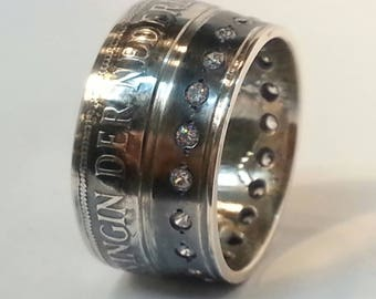 Diamond set coin ring of The Netherlands. Silver. Our own crown jewelry. Hand forged of course. Made from a 1932 silver Dutch coin.