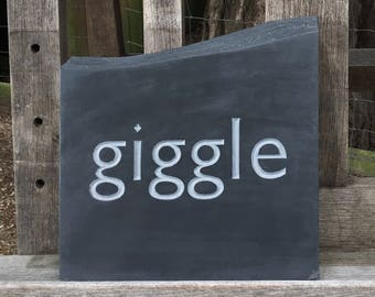 Giggle - hand carved lettering in welsh slate stone