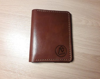 The cover is made of brown genuine leather. Gift to dad. Hand stitch. For auto documents. Holds bills, cards.