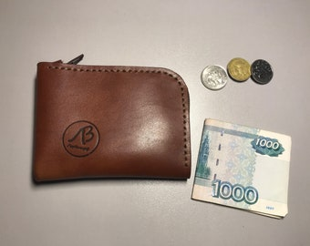 Zipper wallet. genuine leather. Manual work. Holds money, coins, cards. Convenient, practical. Brown, black, red, blue.