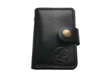 Business card holder made of genuine leather handmade. Holds a lot of CT. Comfortable to wear. Colors: black, brown, red, blue. Practical.