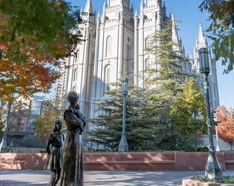 Salt Lake City Temple autumn time with statue of mother and daughter