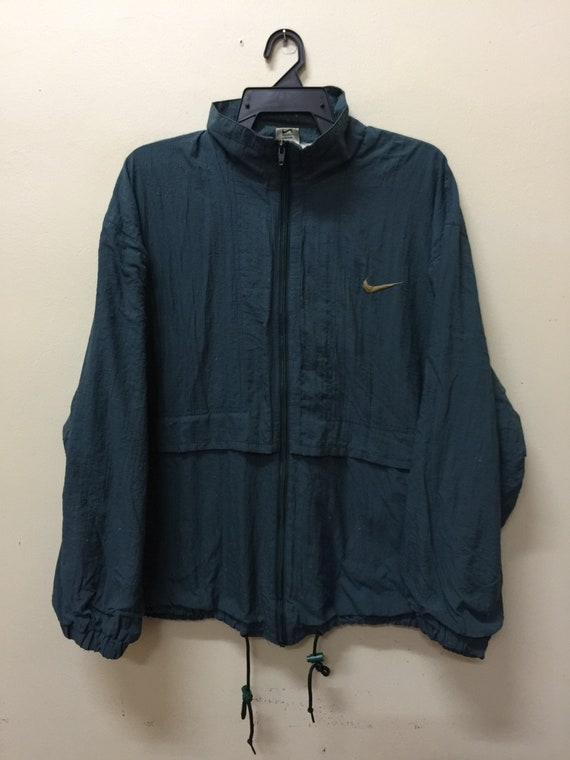 3dac8906ea Vintage Nike Windbreaker Embroidered Logo Zipper Jacket
