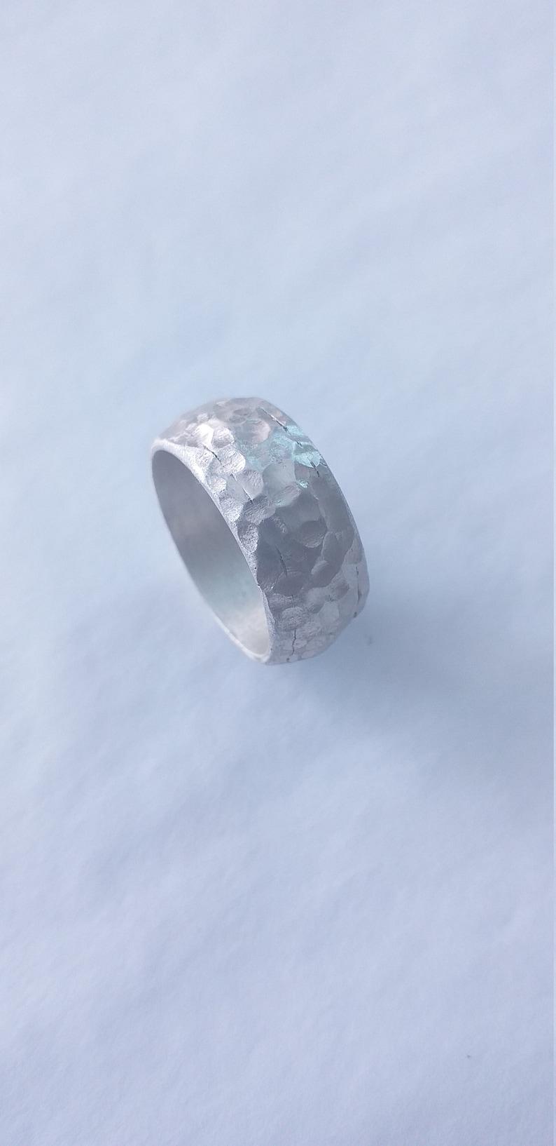Massive silver bulging ring hammered