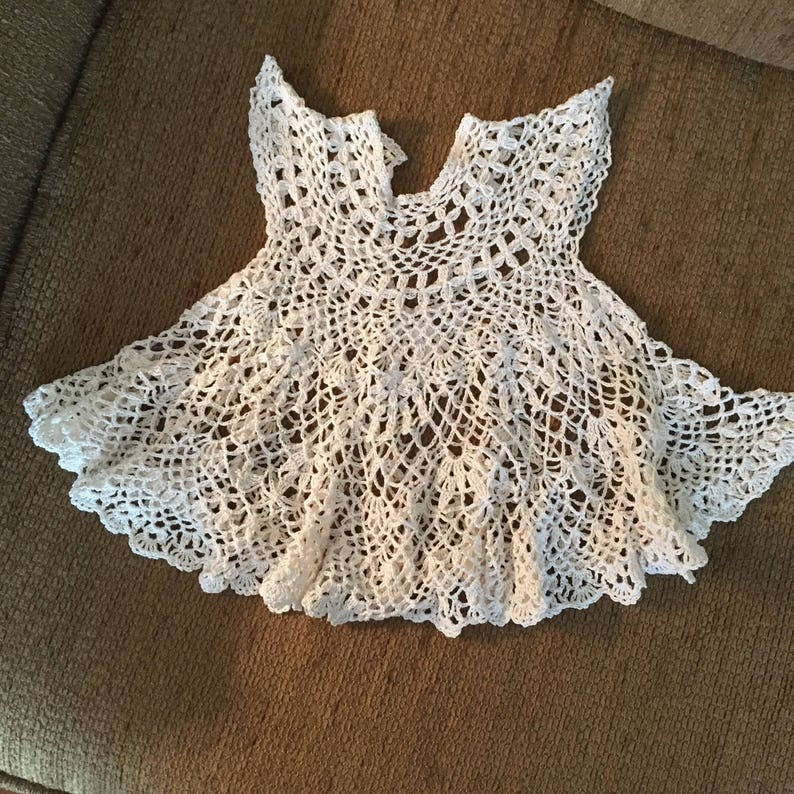 Baby dress in intricate lace