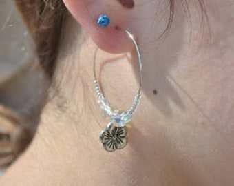 clear and silver hibiscus flower rings