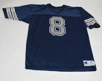 4a480417a Vintage 1990s Dallas Cowboys Troy Aikman Football Jersey made by Champion