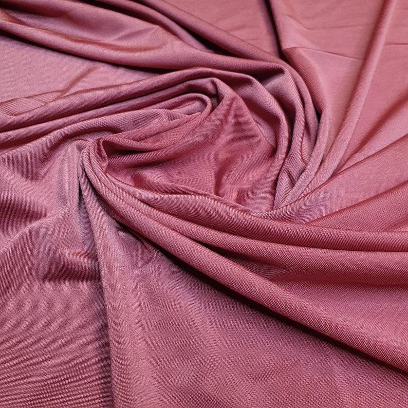 Burnt orange light weight stretch shimmer knit jersey dressmaking fabric price per metre 160cm  63 width